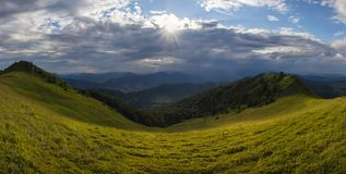 Sunny symmetry. Panoramic view on the ridge in the evening in Ukrainian Carpathians Stock Photo
