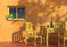 Sunny terrace with flowers and furniture. Sunny orange terrace with flowers in a window and rustic wooden furniture Stock Photo