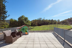 Sunny terrace of house. Lawn and sky background Royalty Free Stock Images