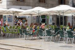 People relax at a sunny terrace in Valencia, Spain Royalty Free Stock Photography