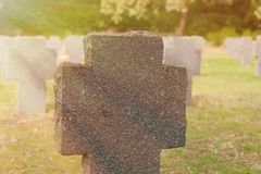 Sunny tomb with stone cross Stock Photography