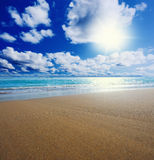 Sunny tropical beach on the island. Beautiful sunny tropical beach on the island paradise in the middle of the sea Stock Photo