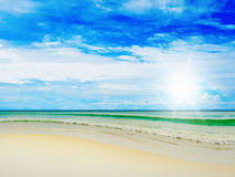 Sunny tropical beach on the island. Beautiful sunny tropical beach on the island paradise in the middle of the sea Stock Images