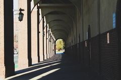 Sunny Tunnel on College Campus stock images