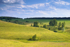 Sunny valley. Fields under the sun in the countryside Stock Photos