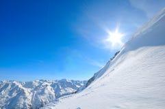 Sunny view. Sun over mountains near Soelden, Austria Stock Photos
