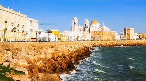 Sunny view of  Cathedral and   coast. Cadiz Stock Images