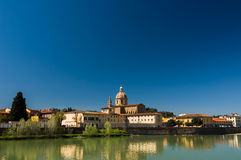 Sunny view of Church San Frediano in Cestello and river Arno. Stock Images