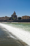 Sunny view of Church San Frediano in Cestello and river Arno. Royalty Free Stock Photography