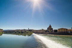 Sunny view of Church San Frediano in Cestello and river Arno. Royalty Free Stock Photos