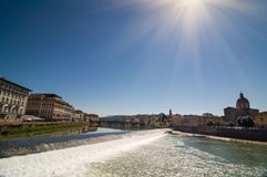 Sunny view of Church San Frediano in Cestello and river Arno. Royalty Free Stock Images