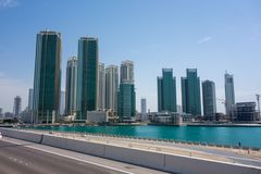 Sunny view of Dubai`s skyline with multiple skyscrapers. Dubai, United Arab Emirates Stock Photos