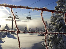 Sunny view of the ski lift. By a safety net Stock Image