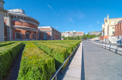 Sunny warm day.  Prado Museum, Museo del Prado - behind the building, church street side, Madrid.  People enjoying sunshine aftern Stock Images