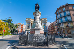 Sunny warm day.  Statue of Maria Christina of Borbon in Madrid, Spain.  People walking along sidewalk. Stock Image
