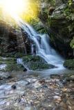 Sunny waterfall Stock Photo