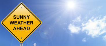 Sunny weather ahead road sign. On bright sky background Stock Image