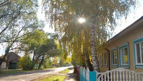 Rural street in Russia on a sunny autumn day royalty free stock photo