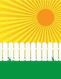 Sunny white fence and grass scene 2. White fence on green grass with a sunny sky Stock Images