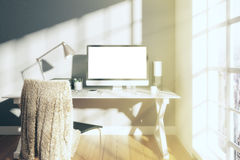 Sunny white room with blank screen monitor of computer Royalty Free Stock Images