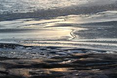 A sunny winter day ashore. Sunlight reflecting from blue ice royalty free stock photography