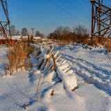 Sunny winter day in the countryside. The sign of winter-icicles Stock Image