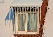 Sunny winter day in the countryside. The sign of winter-icicles Royalty Free Stock Photography
