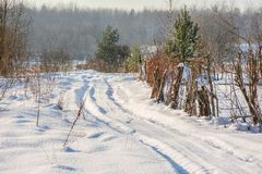 Sunny winter day in the countryside. The sign of winter-icicles Stock Images
