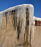 Sunny winter day in the countryside. The sign of winter-icicles Stock Photo