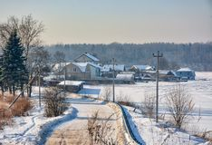 Sunny winter day in the countryside. The sign of winter-icicles Royalty Free Stock Images