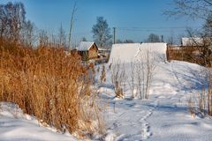 Sunny winter day in the countryside. The sign of winter-icicles Stock Photography