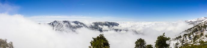 Sunny winter day with fallen snow and a sea of white clouds on the trail to Mt San Antonio (Mt Baldy), Los Angeles county,. Southern California stock photos