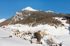 Sunny Winter Day at Idyllic Alpine Village Royalty Free Stock Photo