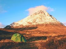 At river Coupall at delta to river Etive. Snowy cone of mountain Stob Dearg 1021 metres high. Royalty Free Stock Photo