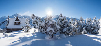 Sunny winter day in the mountains, mountain hut Stock Image