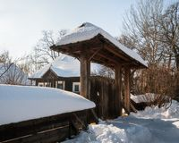 Sunny winter day at an old Romanian House with a wooden gate Stock Photos