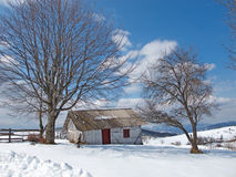 Sunny, winter day with snow and mountain cottages Royalty Free Stock Photos