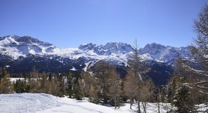 On a sunny winter day the sun shines on the snow-capped Alps royalty free stock photos