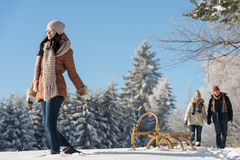 Sunny winter day woman pulling sledge Royalty Free Stock Images