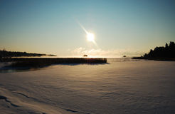 Sunny winter landscape. Bright sunny winter day on a frozen lake stock photography
