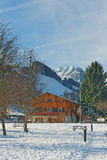 Sunny winter landscape with an Alpine chalet Royalty Free Stock Images