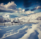 Sunny winter morning in mountain village. Royalty Free Stock Image
