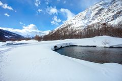 Sunny winter mountain landscape with a bubbling mountain river.  stock images