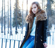 Sunny winter portrait of a beautiful girl in a jacket Stock Photography