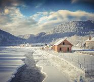 Sunny winter view in Carpathian village with no frozen river. Colorful outdoor scene, Happy New Year celebration concept. Artistic style post processed photo Royalty Free Stock Photo