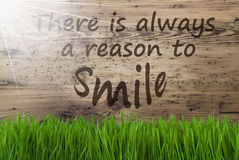 Sunny Wooden Background, Gras, Quote Always Reason To Smile Royalty Free Stock Images