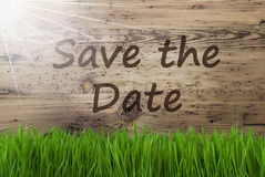 Sunny Wooden Background, Gras, Text Save The Date Stock Photo
