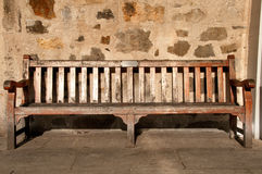 Sunny wooden Park Bench with Memory Plate Royalty Free Stock Photography