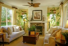 Sunny Yellow Living Room w/Fan. Beautiful Sunny yellow living room with a ceiling fan and granite fireplace couch or sofa a warm tropical look