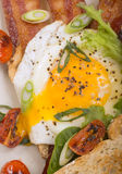 Sunnyside up egg on bacon and toast Stock Image
